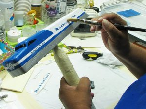 Details are applied to the Art Legacy Award during the customizing phase