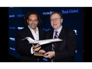 Thomas Flohr, VistaJet CEO and Founder, and Steve Ridolfi, Bombardier President, with a PacMin VistaJet model. // Photo courtesy of Larry Busacca/Getty Images North America